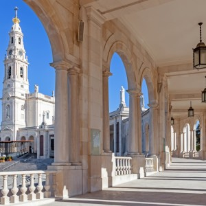 Sanctuary of Fatima, Portugal. Basilica of Our Lady of the Rosary seen from and through the colonnade. One of the most important Marian Shrines and pilgrimage locations for Catholics
